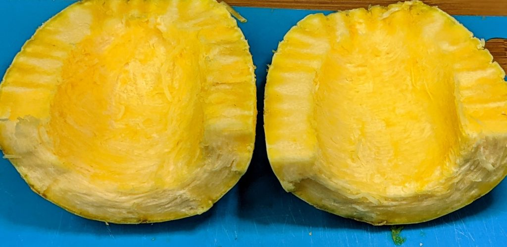 Spaghetti squash cut long ways displayed flesh side up, prior to removing flesh Chase McIntosh Baillie, ©2021 Clemson Extension